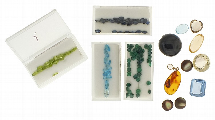 Assorted, cut, precious and semi precious stones, including peridot, sapphire, emerald, topaz, smoky quartz, and others