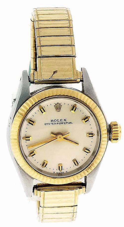 Rolex Watch Co., Switzerland, lady's wrist watch, ref. 6619, cal. 1161, 26 jewels, automatic winding nickel plate movement with lever escapement in a stainless steel case with gold bezel, brushed metal dial and gold baton hands, serial #2710028