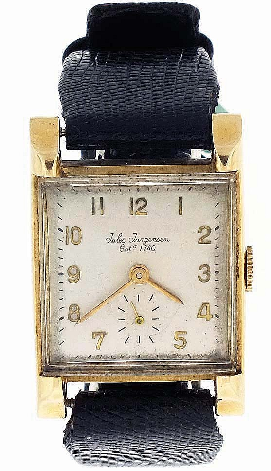 Jules Jurgensen Corp., Switzerland, man's wrist watch, 17 jewels, manual winding nickel plate movement with lever escapement in a 14 karat yellow gold case, the back with engraved presentation, Arabic numeral silvered dial and gold baton hands,