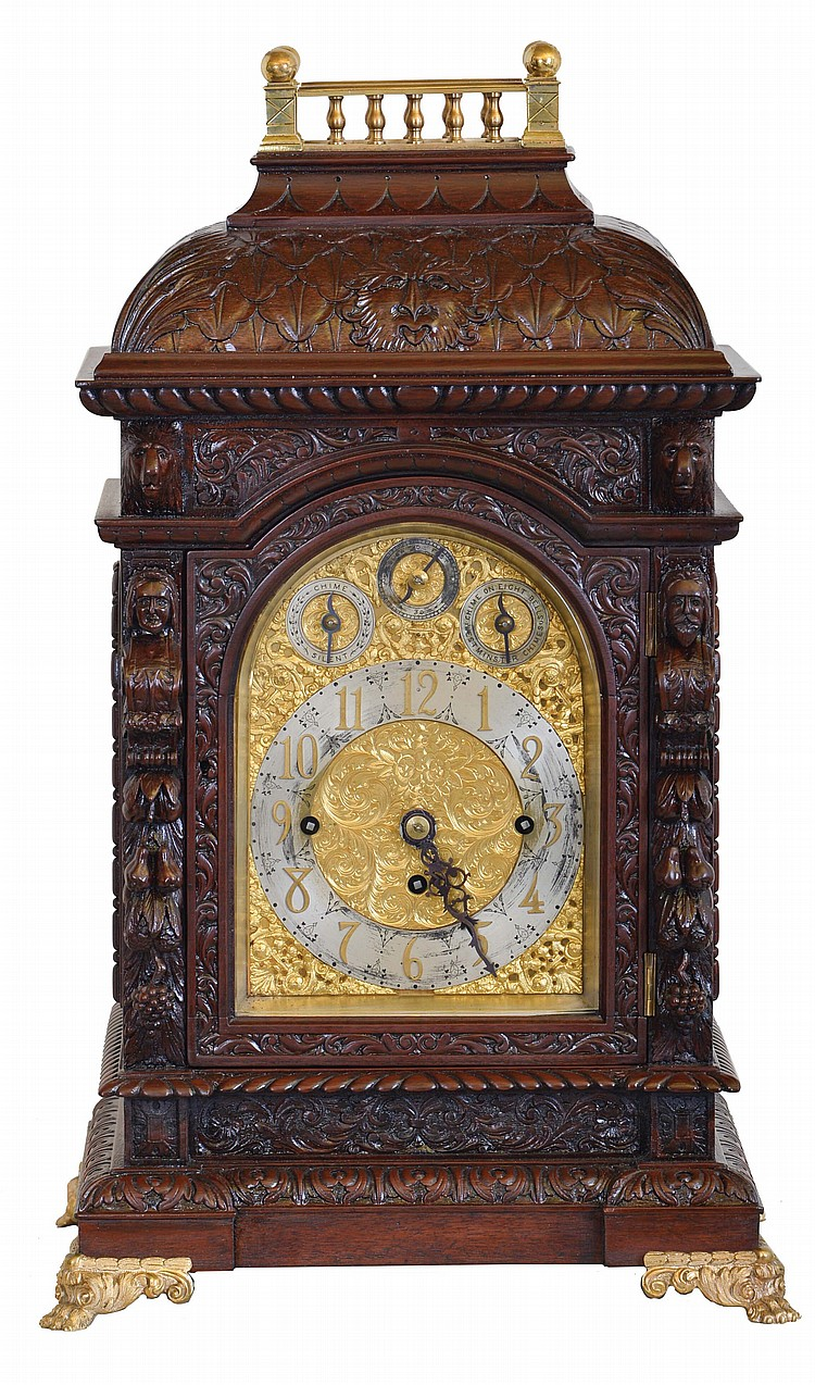 England, unsigned large, three train chiming bracket clock, mahogany case richly ornamented with low and high relief carving, with brass balustrade at top, and resting on gilt paw feet, door with beveled glass, composite dial with Arabic numeral