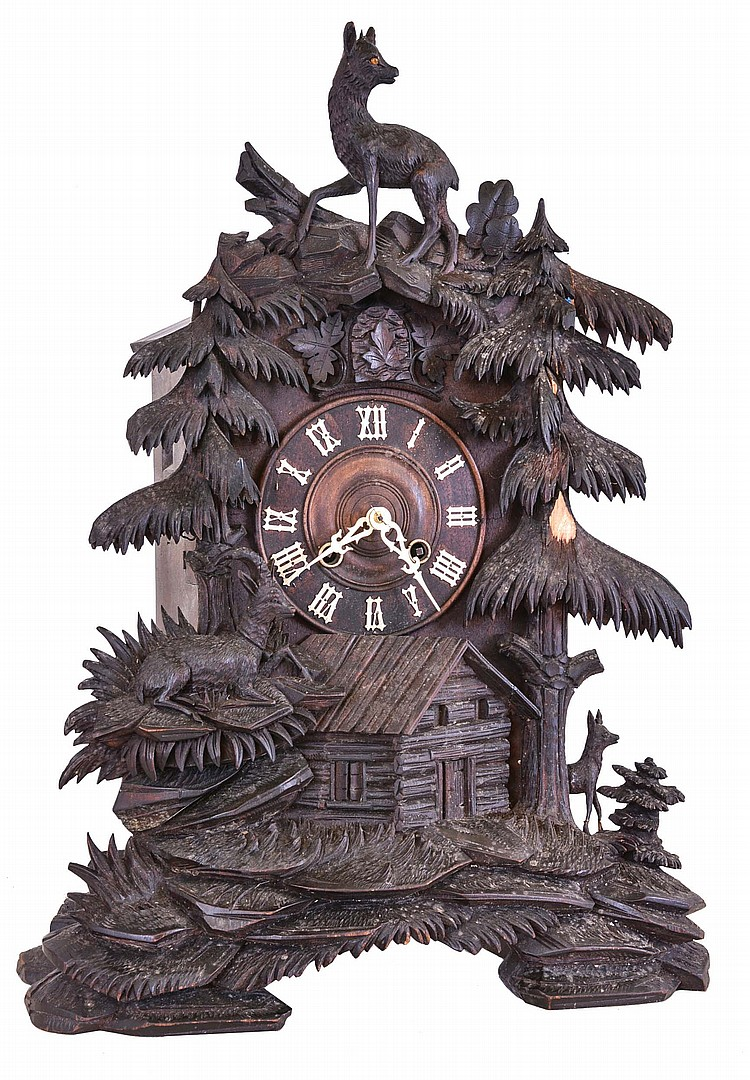 Germany, large shelf cuckoo, the case carved with Alpine landscape incorporating a cabin, trees and various animals, turned wooden dial with applied Roman numerals, 8 day, two train brass spring driven movement, the strike train with a fusee