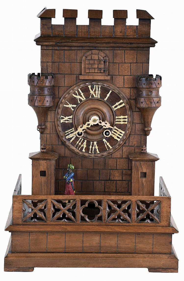 Germany, shelf cuckoo with sentry automata, carved wooden architectural case of Gothic design, molded base with pierced railing enclosing the structure; the building with guard shelters, turrets, and crenellated parapet, and Turkish guard marching