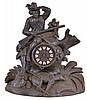 Germany, a large black forest figural mantel clock, the case with seated hunter scanning the horizon, (perhaps waiting for a bus), with carved stump, rocks, foliage, and kill at his feet, wooden dial with applied Roman numeral cartouches, blued steel