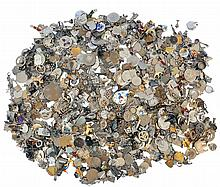 Large lot of charms and pendants, many marked sterling, approximately 58 Troy oz.