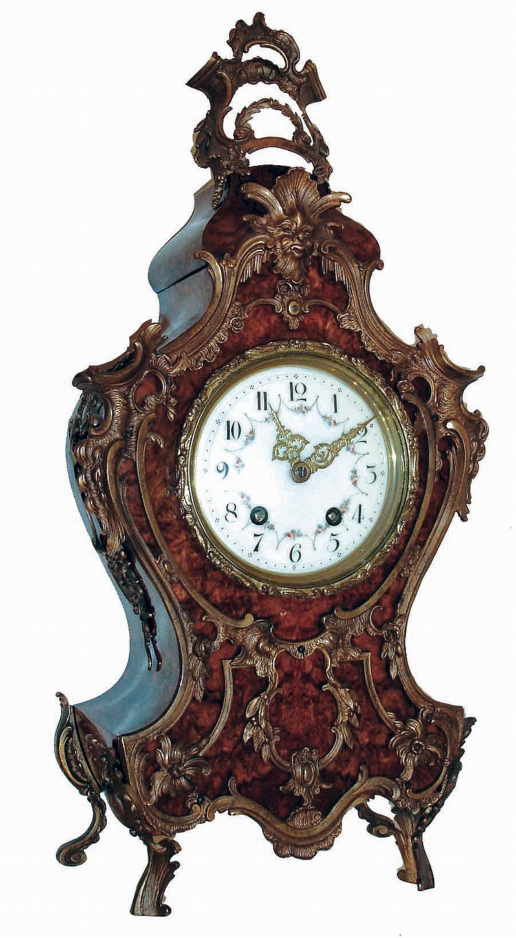 Lenzkirch, Germany, shelf clock in the Neuchatel style, burl walnut veneered case, heavily ornamented with gilt, cast brass mounts in the French style, gilt bezel with similar decoration, Arabic numeral white enamel dial with polychrome enamel floral