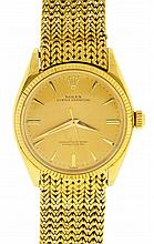 Rolex Watch Co., Switzerland, Ref. 1005, caliber 1560, 25 jewels, automatic winding, adjusted to 5 positions and temperature, nickel plate movement with lever escapement in an 18 karat, yellow gold case, with baton and arrow marker metal dial, gold