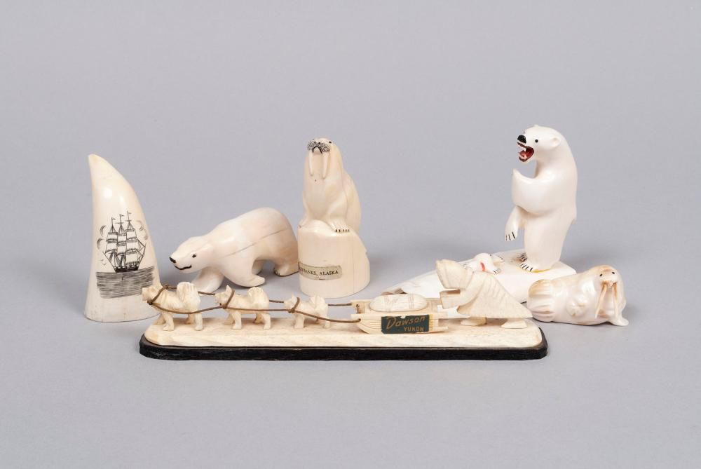 SIX FOSSIL AND BONE INUIT CARVINGS