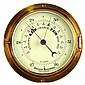A mid C20th brass bulkhead aneroid barometer,
