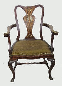 An Edwardian mahogany armchair, having central