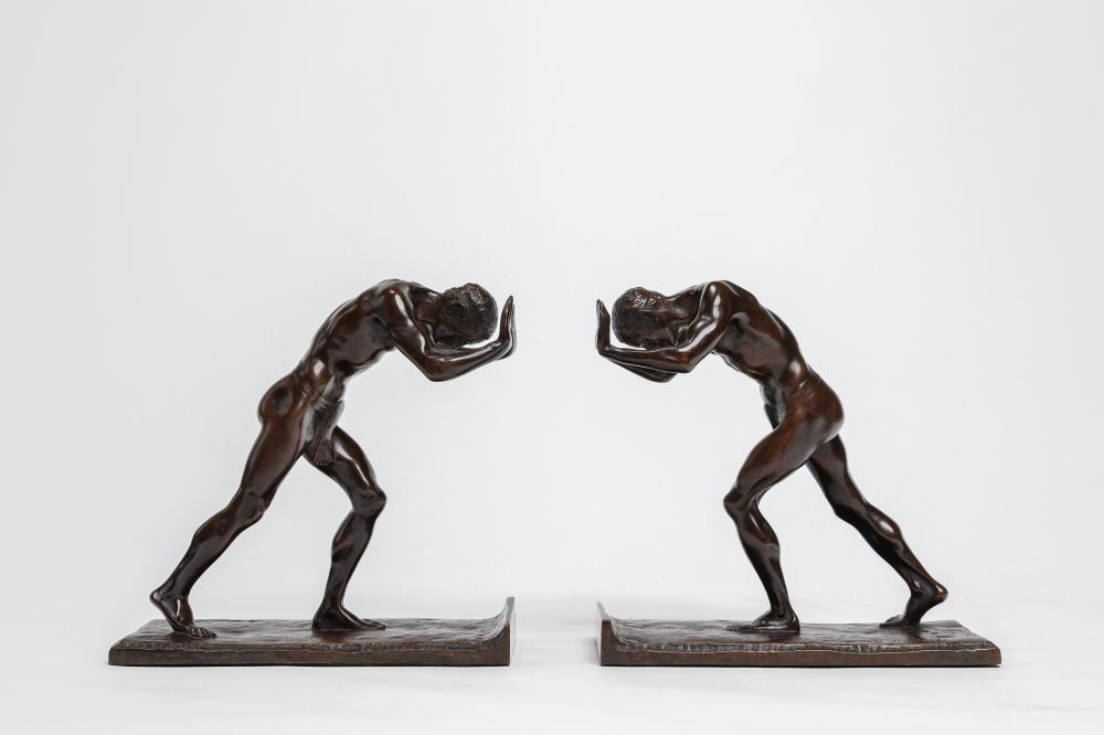 """ISIDORE KONTI, American (1862-1938), """"Pushing Men"""", (A Pair of Bookends), bronze, height: 6 inches"""