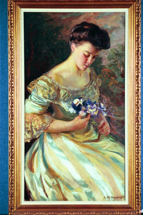 ARTHUR MERTON HAZARD American (1872-1930) Young Woman with Flowers, oil on canvas, 40 x 22, signed lower right & dated '05. See color plate page 44.