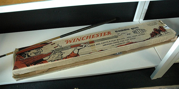 A 1960's Mettoy Winchester saddle toy gun, in