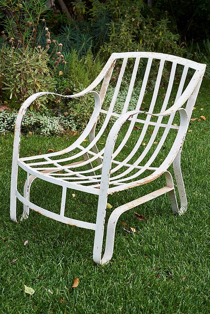 set of four white painted wrought iron garden lounge chairs