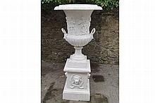 PAIR OF LARGE CAST IRON URNS AND STANDS