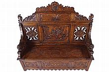 NINETEENTH-CENTURY PROFUSELY CARVED OAK MONKS BENCH