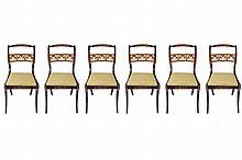 SET OF SIX EBONY AND PARCEL GILT DINING CHAIRS