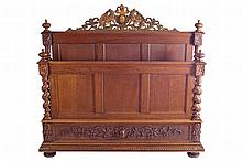 LARGE NINETEENTH-CENTURY CARVED OAK BED