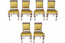 SET OF SIX REGENCY PERIOD WHITE AND PARCEL GILT CHAIRS