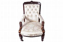 NINETEENTH-CENTURY MAHOGANY AND UPHOLSTERED LIBRARY CHAIR