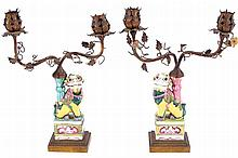 PAIR OF BRASS MOUNTED POLYCHROME FO DOG STEMMED CANDELABRAS