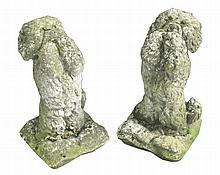 Pair reconstituted stone poodles