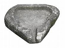 Triangular shaped stone trough with water outlet, circa 1800