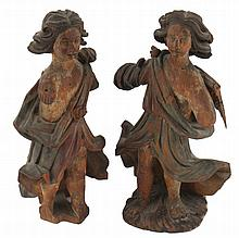 Two early carved wood angels