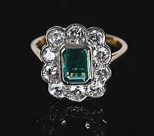 18 ct. white gold 1.5 ct. diamond and 1.10 ct. emerald ring