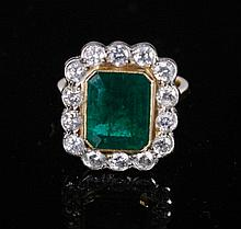 18 ct. yellow gold 1.35 ct. diamond and emerald of 4.55 ct. ring