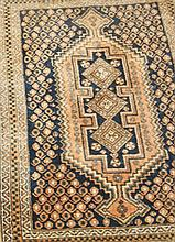 Group of four small Persian rugs