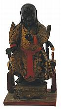 Chinese Qing period lacquered and gilt figure of an Immortal