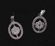 Pair of 18 ct. white gold and diamond earrings