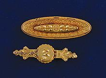 Two 15 ct. gold brooches, .040 oz.