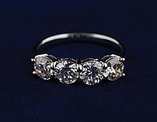 Four stone diamond ring set in 18 ct. white gold,