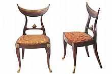 PAIR OF NIENTEENTH-CENTURY ORMOLU MOUNTED CRESCENT BACK CHAIRS
