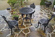 CIRCULAR  CAST IRON PATIO TABLE AND THREE MATCHING CHAIRS