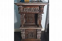 NINETEENTH-CENTURY PROFUSELY CARVED OAK HANGING WALL CABINET