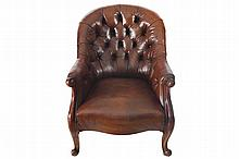 PAIR OF NINETEENTH-CENTURY MAHOGANY AND HIDE UPHOLSTERED DEEP BUTTONED LIBRARY CHAIRS