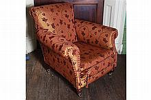 NINETEENTH-CENTURY UPHOLSTERED SCROLL BACK ARMCHAIR