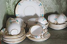 THIRTY PIECE NINETEENTH-CENTURY POLYCHROME AND PARCEL GILT CHINA TEA SET