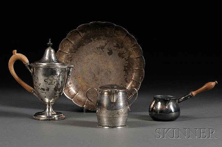 Four Pieces of Georgian Silver, each London: a butter warmer, 1735-36, John Gamon, maker, with squat bulbous body and turned wood ha...