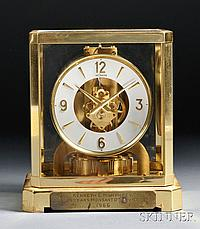 LeCoultre Atmos Clock, Switzerland, with brass and glass case, Arabic numeral dial marked LeCoultre, mechanical elements powered by atm