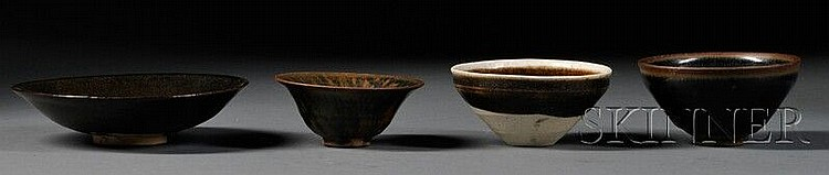 Four Temmoku Bowls, China, Sung dynasty (960-1279), two hare's fur, one with white rim, and one with black glaze, dia. to 6 5/8 in.