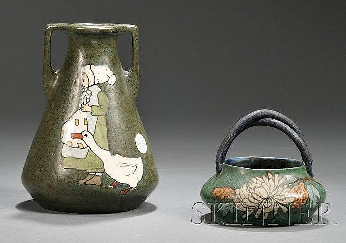 , Two Eduard Stellmacher Vases, Decorated earthenware, A flared body vase with two angled handles, decorated on the side with a girl an