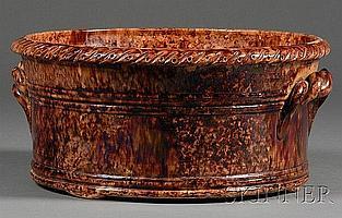 Large Rockingham Glazed Redware Basin, John Bell, Waynesboro, Pennsylvania, c. 1860, the basin with ropetwist handles and molded rim, i