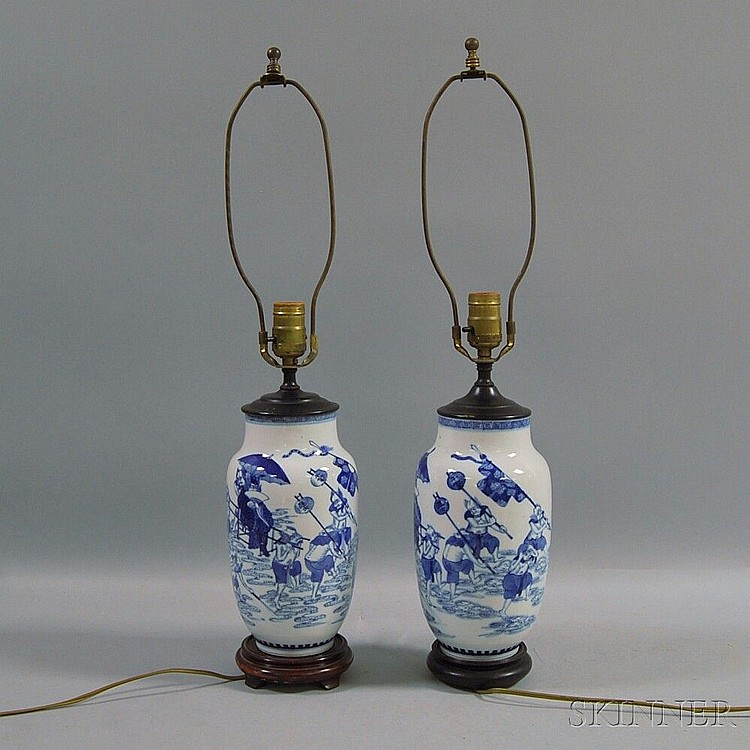 Pair of Blue and White Chinese Porcelain Vasiform Lamps, depicting a man being carried by servants, on footed wooden base, ht. 11 1/2 i