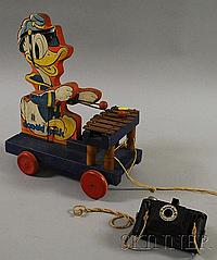 Fisher Price 1938 Donald Duck Wooden Musical Pull-toy, sold with a Herbert-George Co. Walt Disney Donald Duck camera.