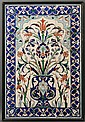Iznik-style Tile Panel, Ottoman Turkey, comprising twelve square tiles, the white ground decorated red, blue, and green, depicting tuli