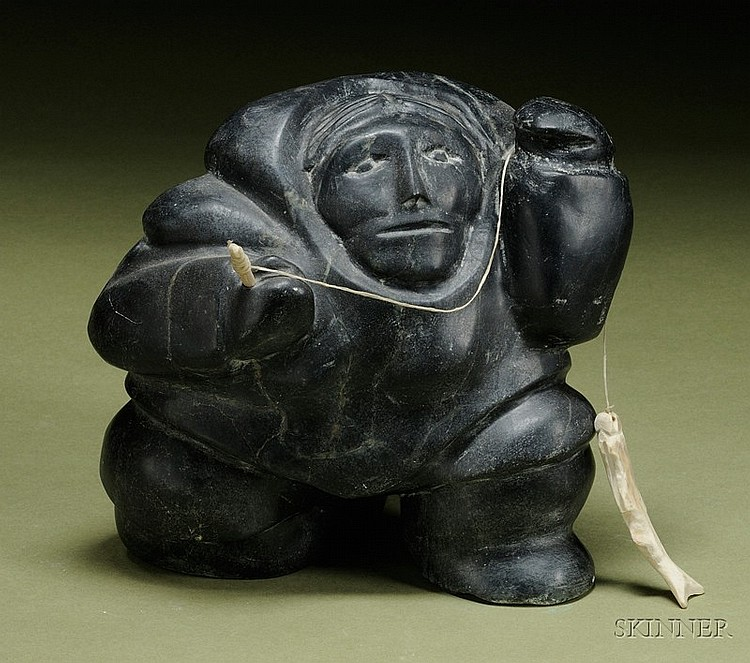 Contemporary Inuit Stone and Bone Carving, by Peter Sevoga, titled Woman Icefishing, ht. 9 1/2, wd. 10 1/2 i...
