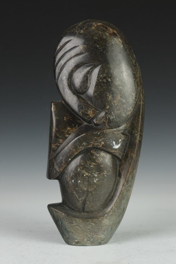 African carved and polished green stone sleeping figure